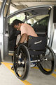 Free Stock Photo: A disabled man in a wheelchair getting out of a car