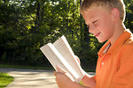 Free Stock Photo: A boy reading a book