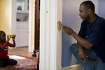 Free Stock Photo: A man repairing a door frame in his home