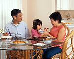 Free Stock Photo: An Asian family eating a meal at the table