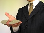 Free Stock Photo: Business man holding a comopact disc