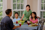 Free Stock Photo: An Asian family eating dinner at a table