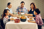 Free Stock Photo: A Hispanic family eating lunch at a kitchen table