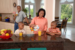Free Stock Photo: An African-American family in a kitchen drinking juice