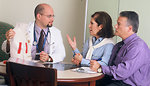 Free Stock Photo: A doctor and couple talking