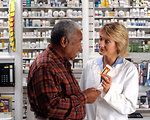 Free Stock Photo: A man consulting his pharmacist