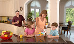 Free Stock Photo: A family drinking juice in the kitchen