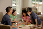 Free Stock Photo: A family playing a board game