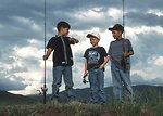 Free Stock Photo: Three young boys with fishing poles