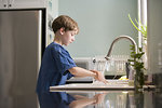 Free Stock Photo: A young boy washing his hands