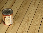 Free Stock Photo: Can of wood stain on a wooden deck