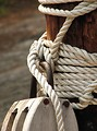 Free Stock Photo: Closeup of rope and a wooden pulley