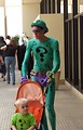 Free Stock Photo: Man in Riddler costume with boy in stroller at Dragoncon 2008