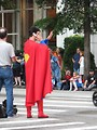 Free Stock Photo: Man in Superman costume on a cell phone crossing the street at the 2008 Dragoncon parade in Atlanta, Georgia.