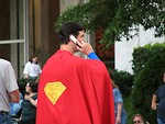 Free Stock Photo: Man in Superman costume on cell phone at Dragoncon 2008