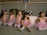 Free Stock Photo: A group of young ballerinas sitting in front of a mirror