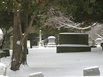 Free Stock Photo: A snow covered tombstone in a graveyard.