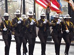 Free Stock Photo: Police officers marching with flags in the 2009 Atlanta Saint Patricks Day Parade