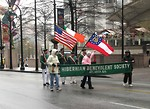 Free Stock Photo: People marching with flags in the 2009 Atlanta Saint Patricks Day Parade.