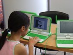 Free Stock Photo: Young girl using an OLPC laptop