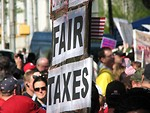 Free Stock Photo: Protest flags and signs at the 2009 tax day tea party in Atlanta, Georgia