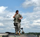 Free Stock Photo: A female soldier on top of a humvee at the 2009 Robins AFB Air Show.