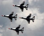 Free Stock Photo: F-16 Air Force Thunderbird jets flying in formation at the 2009 Robins AFB Air Show.