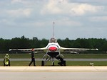 Free Stock Photo: An F-16 Air Force Thunderbird jet with crew members on a runway at the 2009 Robins AFB Air Show.