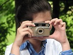 Free Stock Photo: Close-up of a young girl taking a picture with a camera