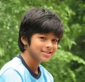 Free Stock Photo: Close-up of a young latino boy posing by the woods