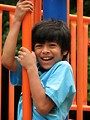 Free Stock Photo: A young latino boy playing on a playground