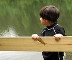 Free Stock Photo: A young latino boy looking over a lake