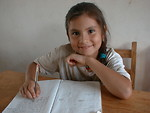 Free Stock Photo: Girl with notebook in new class room provided by the Solar.net Village project.