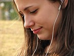 Free Stock Photo: A teenage girl listening to a music player.