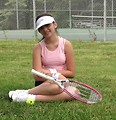 Free Stock Photo: A beautiful teen latina girl posing with tennis gear
