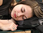 Free Stock Photo: Closeup of a teen girl sleeping on a bench.