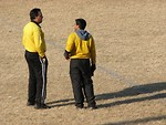 Free Stock Photo: Two soccer referees talking