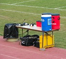 Free Stock Photo: Water coolers and headsets on a sports field sideline