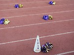 Free Stock Photo: Pom poms and a megaphone on a track field