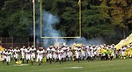 Free Stock Photo: A high school football team chargin onto the field