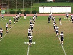 Free Stock Photo: A high school football team warming up before a game