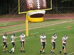 Free Stock Photo: High school football players warming up before a game