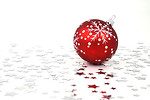 Free Stock Photo: A red Christmas ornament with silver stars on the floor