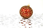 Free Stock Photo: A red Christmas ornament on a white floor with silver stars