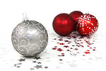 Free Stock Photo: Red and silver Christmas ornaments with silver stars on a white floor