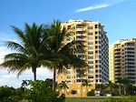 Free Stock Photo: Condos along the ocean with palm trees.