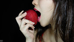 Free Stock Photo: A beautiful woman eating an apple